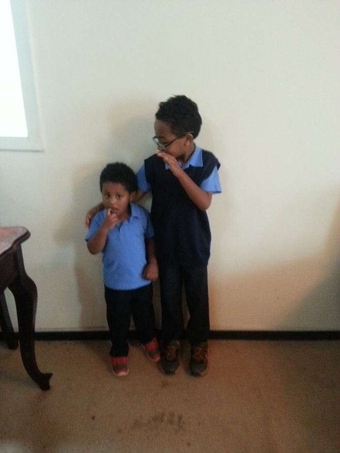 The Kassa boys in their new school uniforms